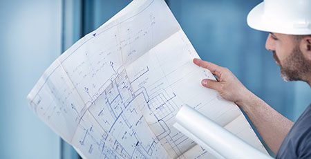 architect with blueprints